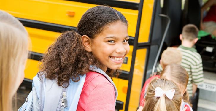 Girl on School Bus